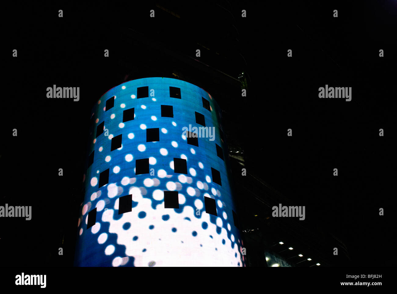 Light projected on a round building, New York, USA. - Stock Image