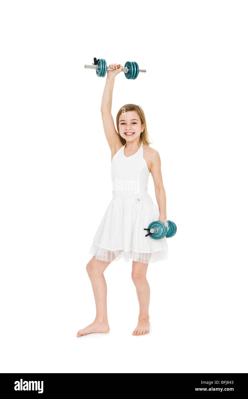A girl working out. - Stock Image