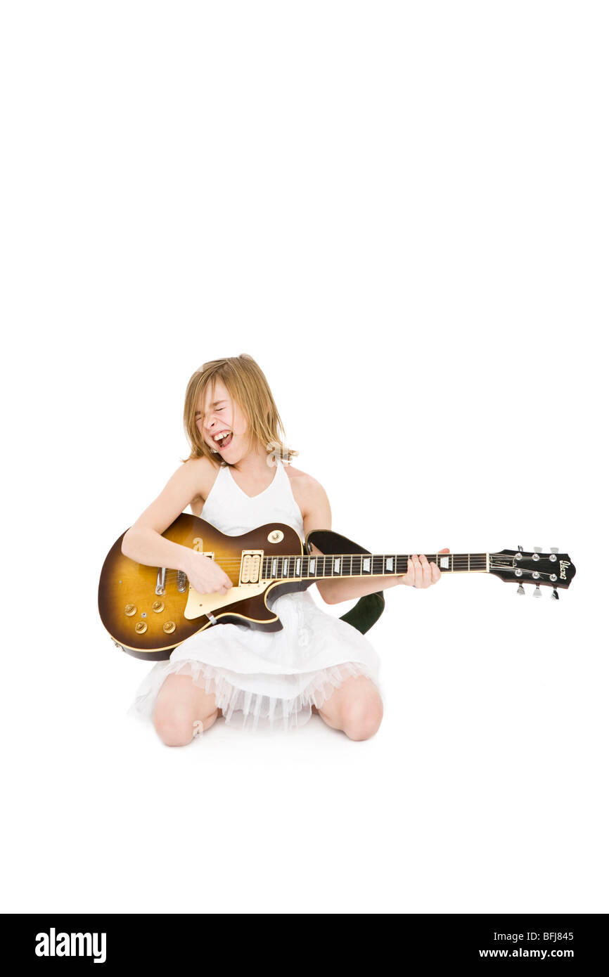A girl playing music. - Stock Image
