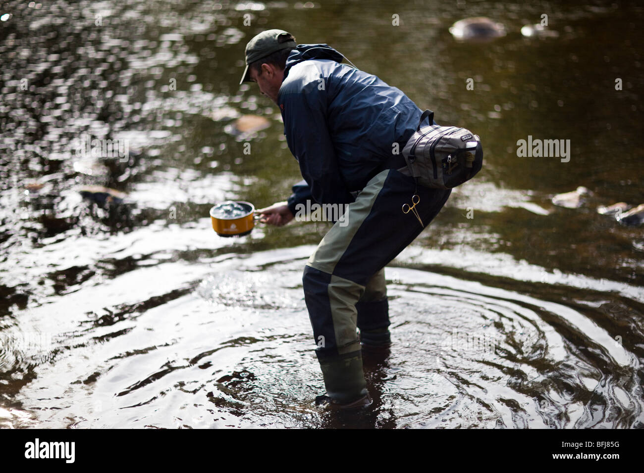 A fly-fishing man with a cooking-utensil, Sweden. - Stock Image