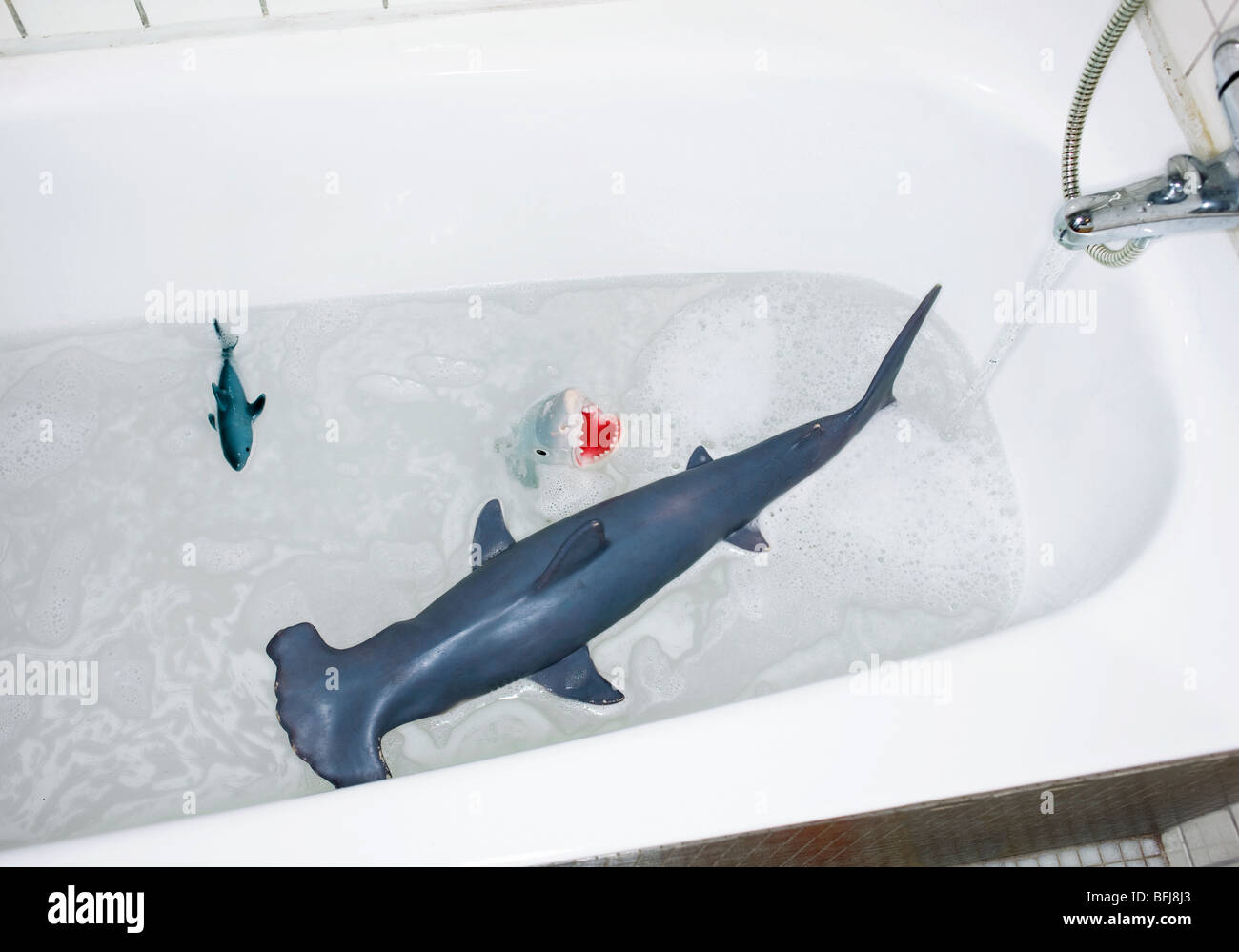 Toys in a bath tub, Sweden. - Stock Image