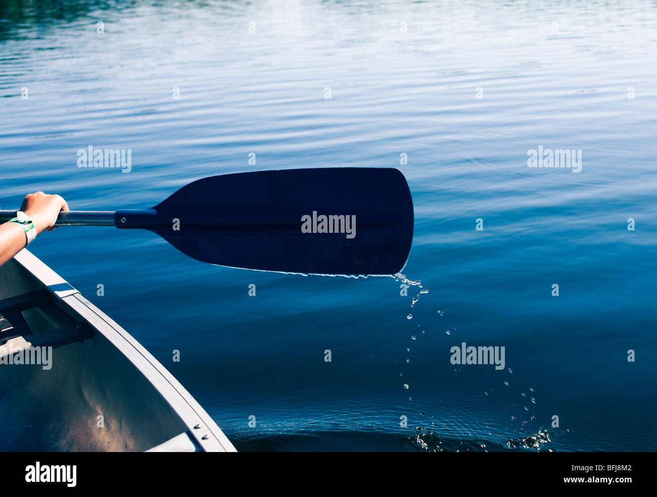 A boy in a canoe, Sweden. - Stock Image