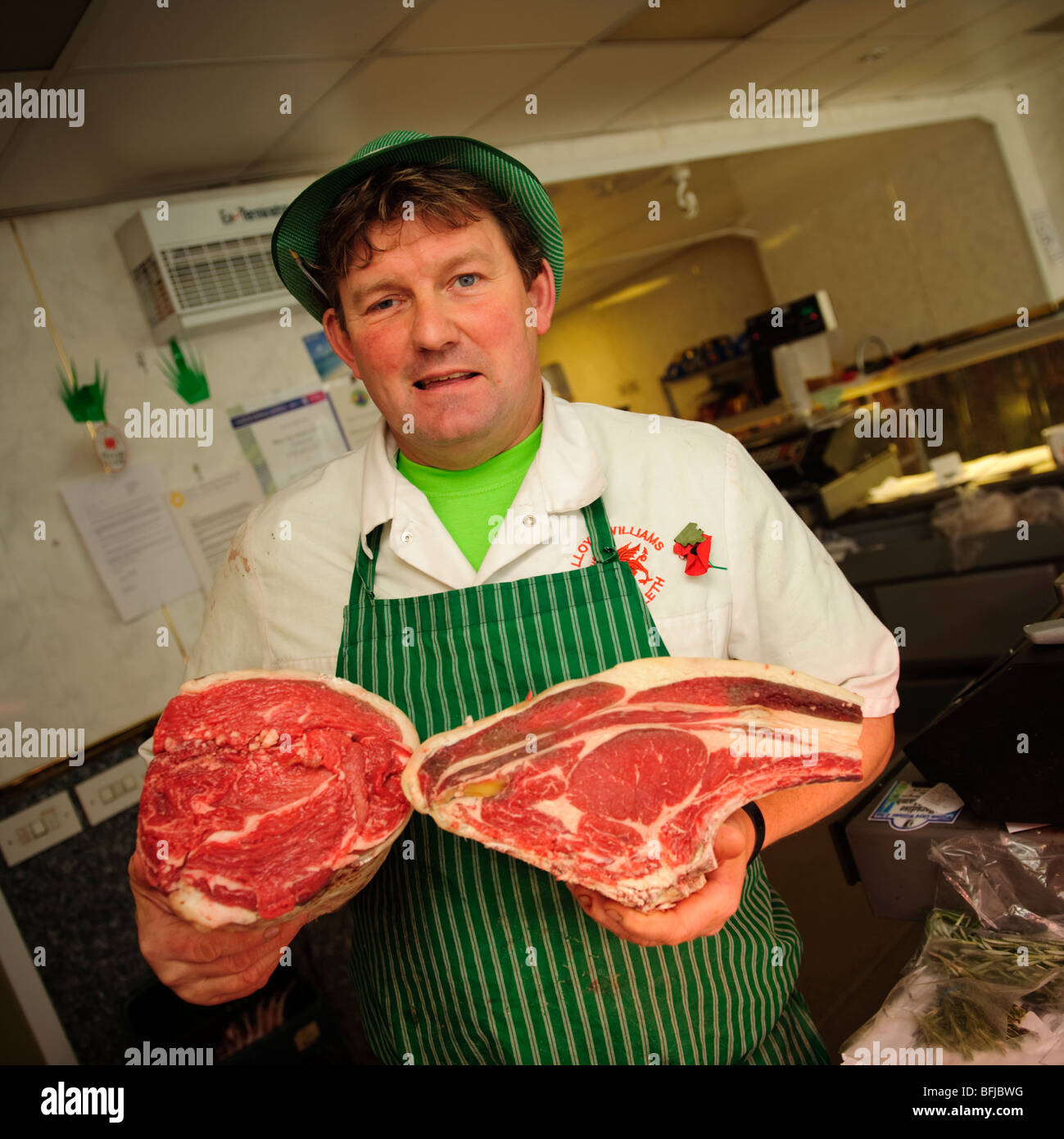 William Lloyd Williams MBE, butcher, Machynlleth , Powys Wales UK, holding joints of prime locally produced beef - Stock Image