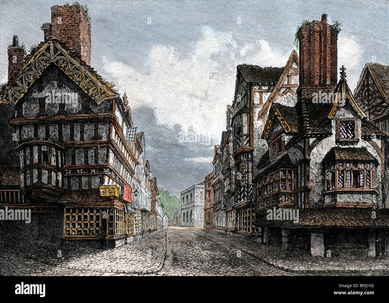 High Street, Shrewsbury, in Tudor England. Hand-colored woodcut - Stock Image