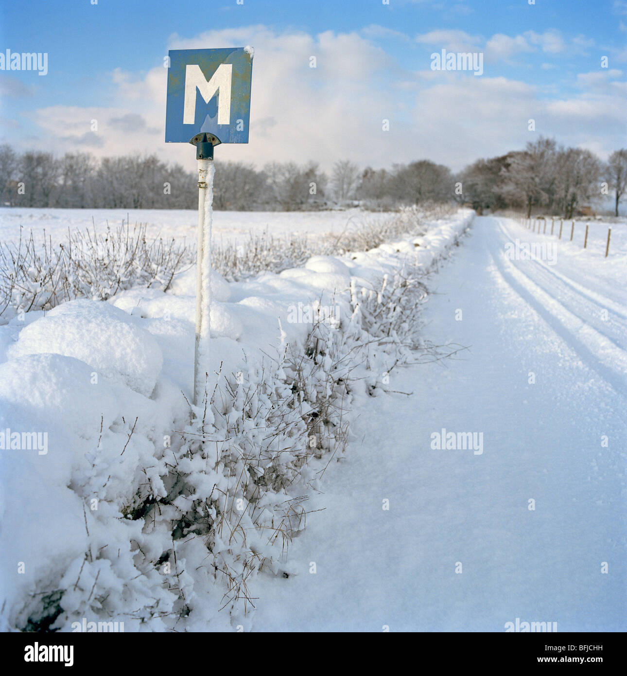 A meeting sign on a winter road, Sweden. - Stock Image