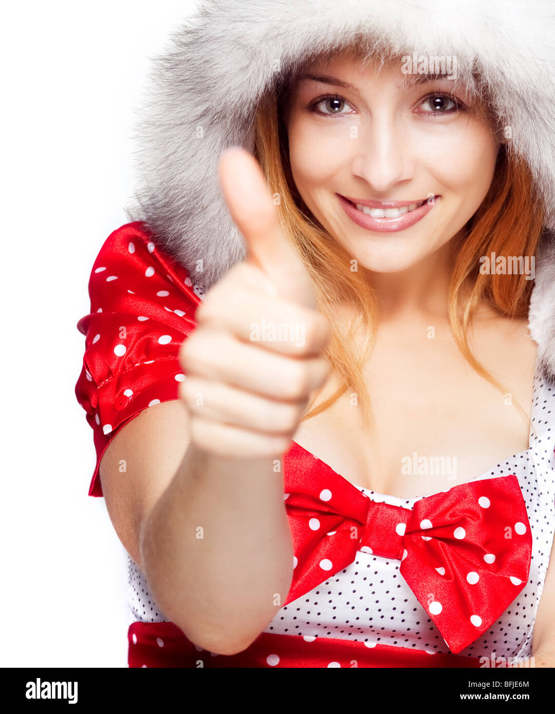 Winter portrait of happy woman showing ok sign - Stock Image