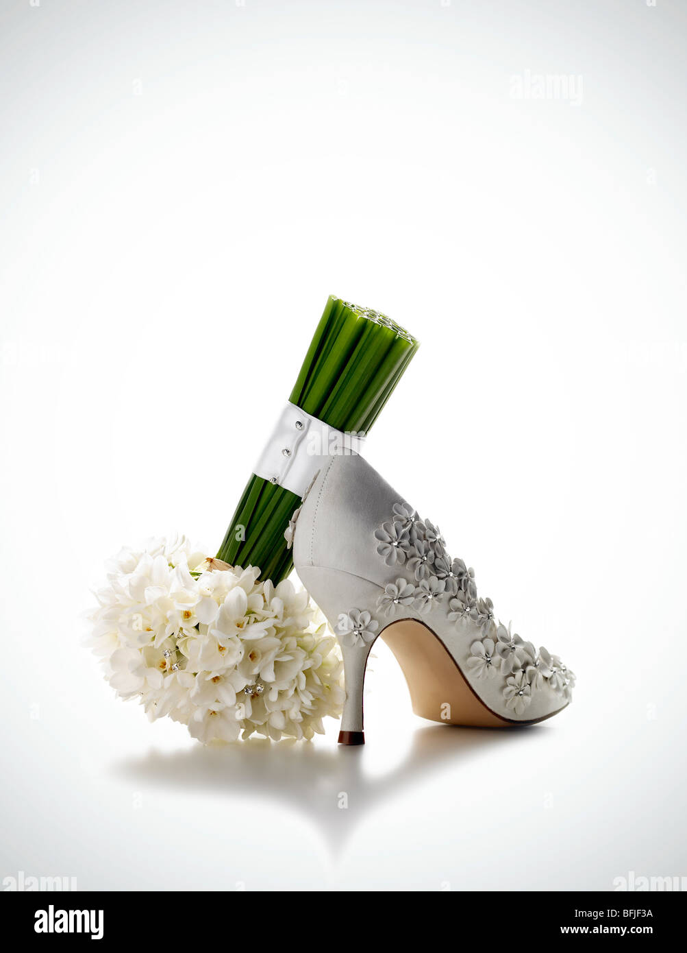 bridal shoe and flowers - Stock Image