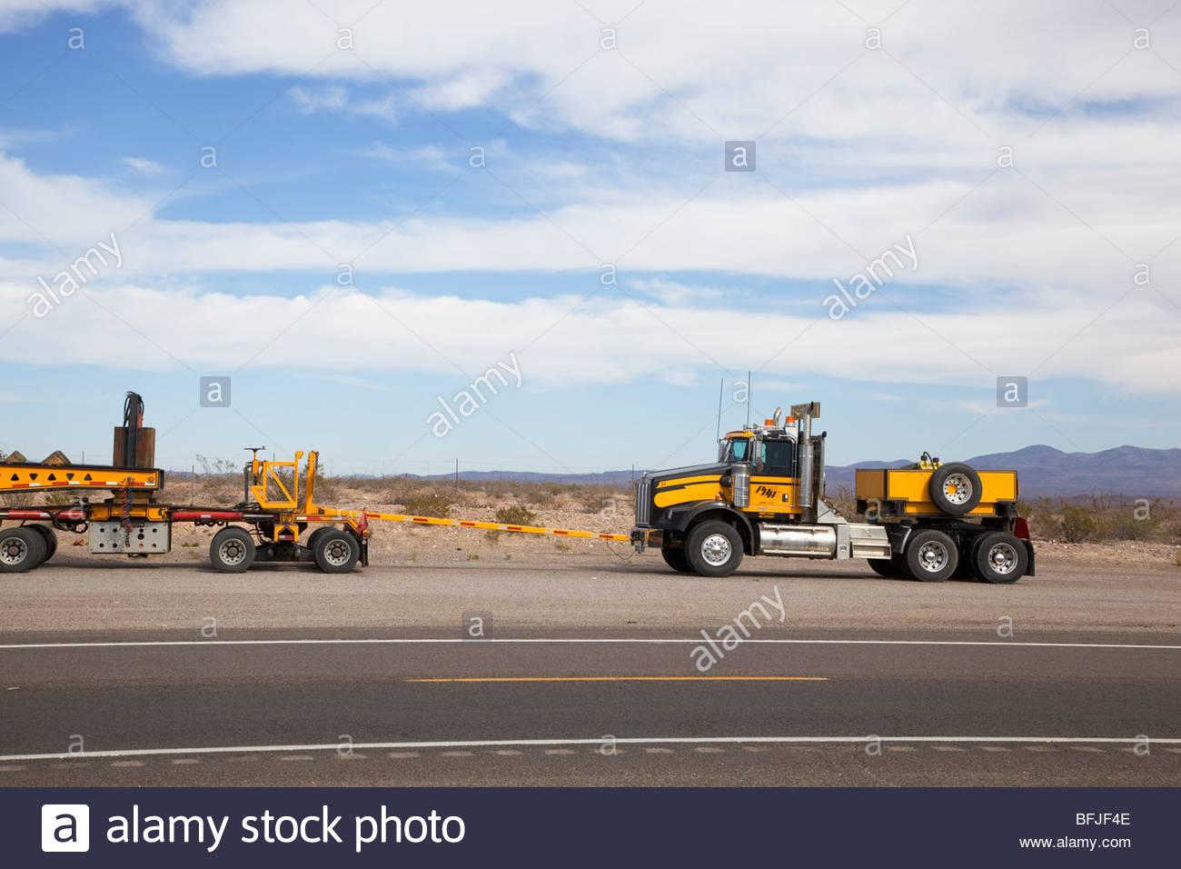 Heavy hauling oversize load detail tractor pushing parked Arizona - Stock Image