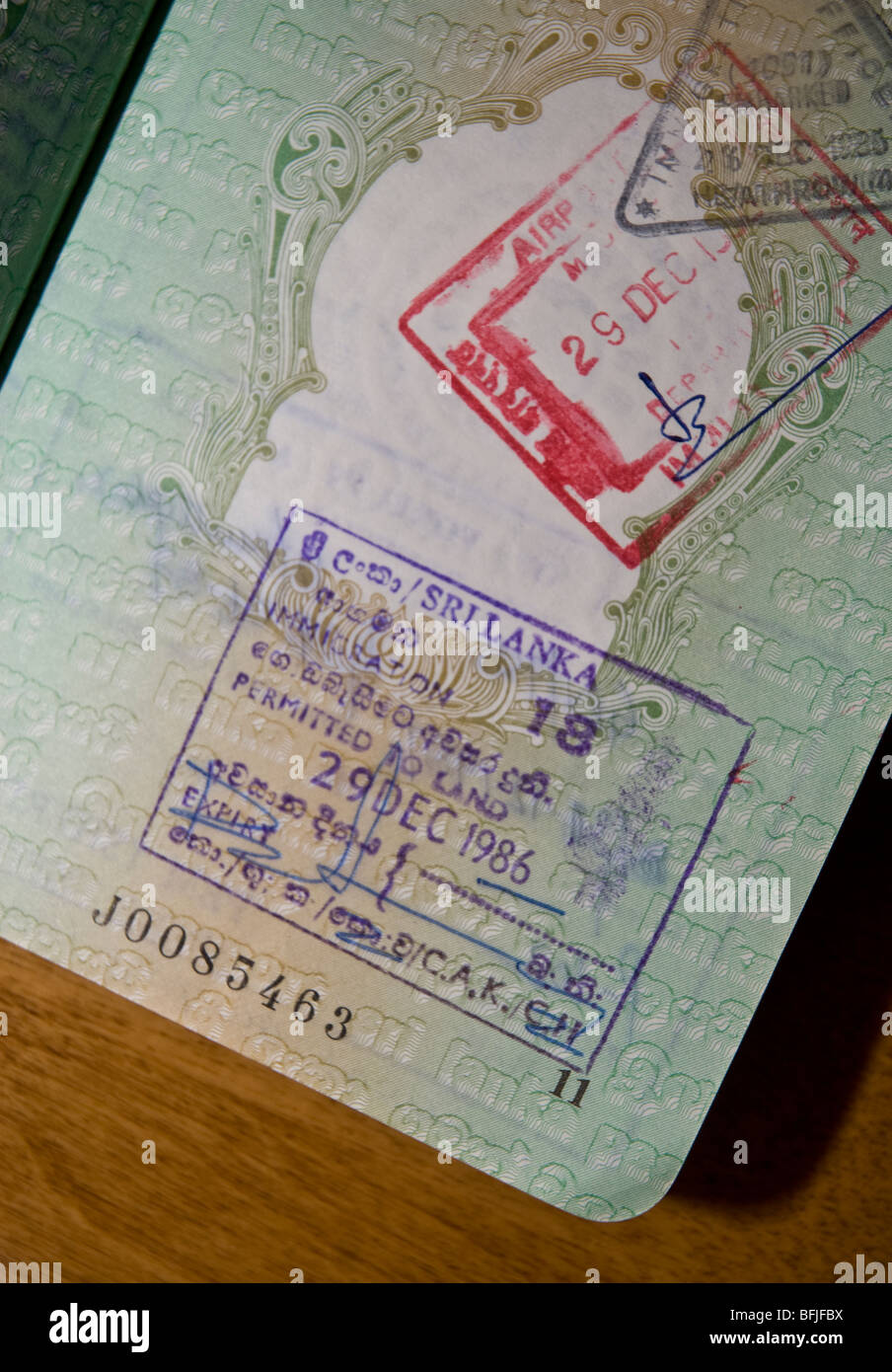 International immigration stamps and visas in a passport - Stock Image