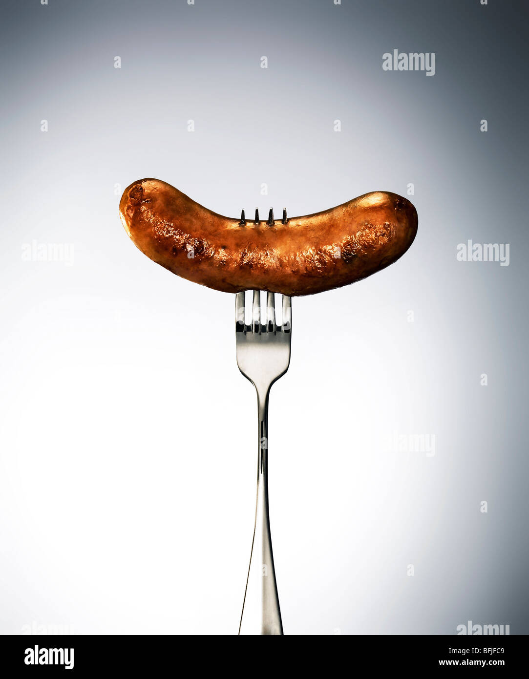 suasage on a fork Stock Photo