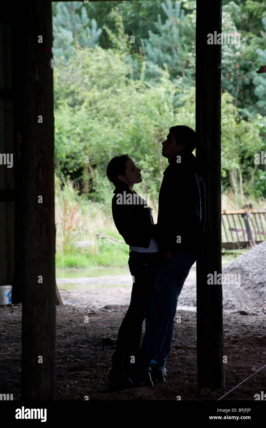 Stock video of silhouette of a young couple kissing