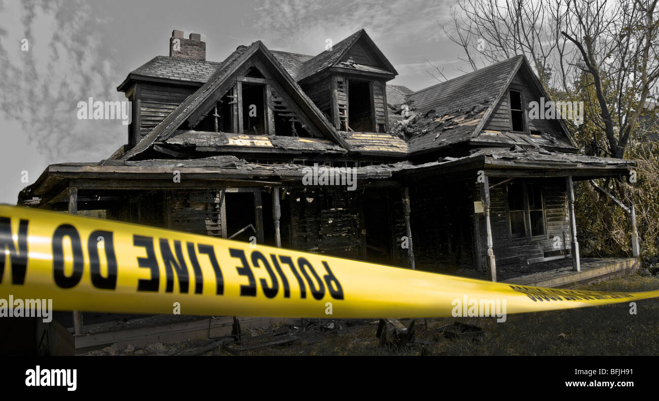 Police barricade tape in front of fire damaged house in North Carolina, USA - Stock Image