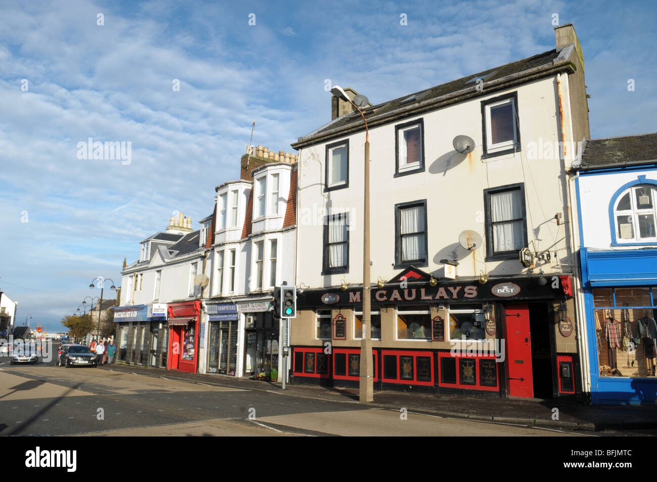 A pub and shops in the seaside town of Largs in Scotland. - Stock Image