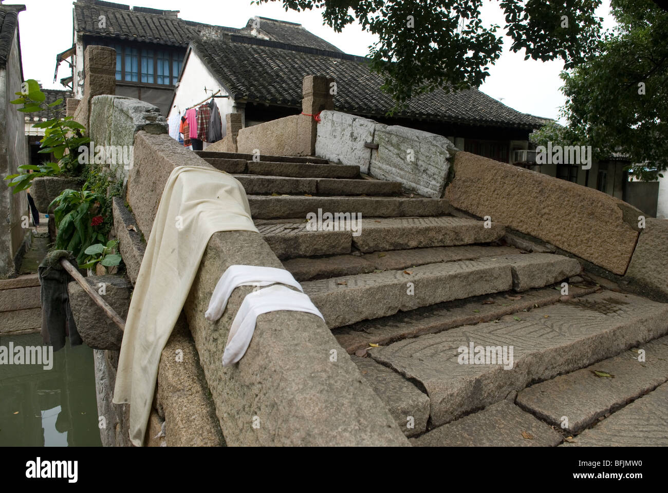 One of the arched bridges in the small ancient town of Luzhi, Jiangsu province, China. - Stock Image