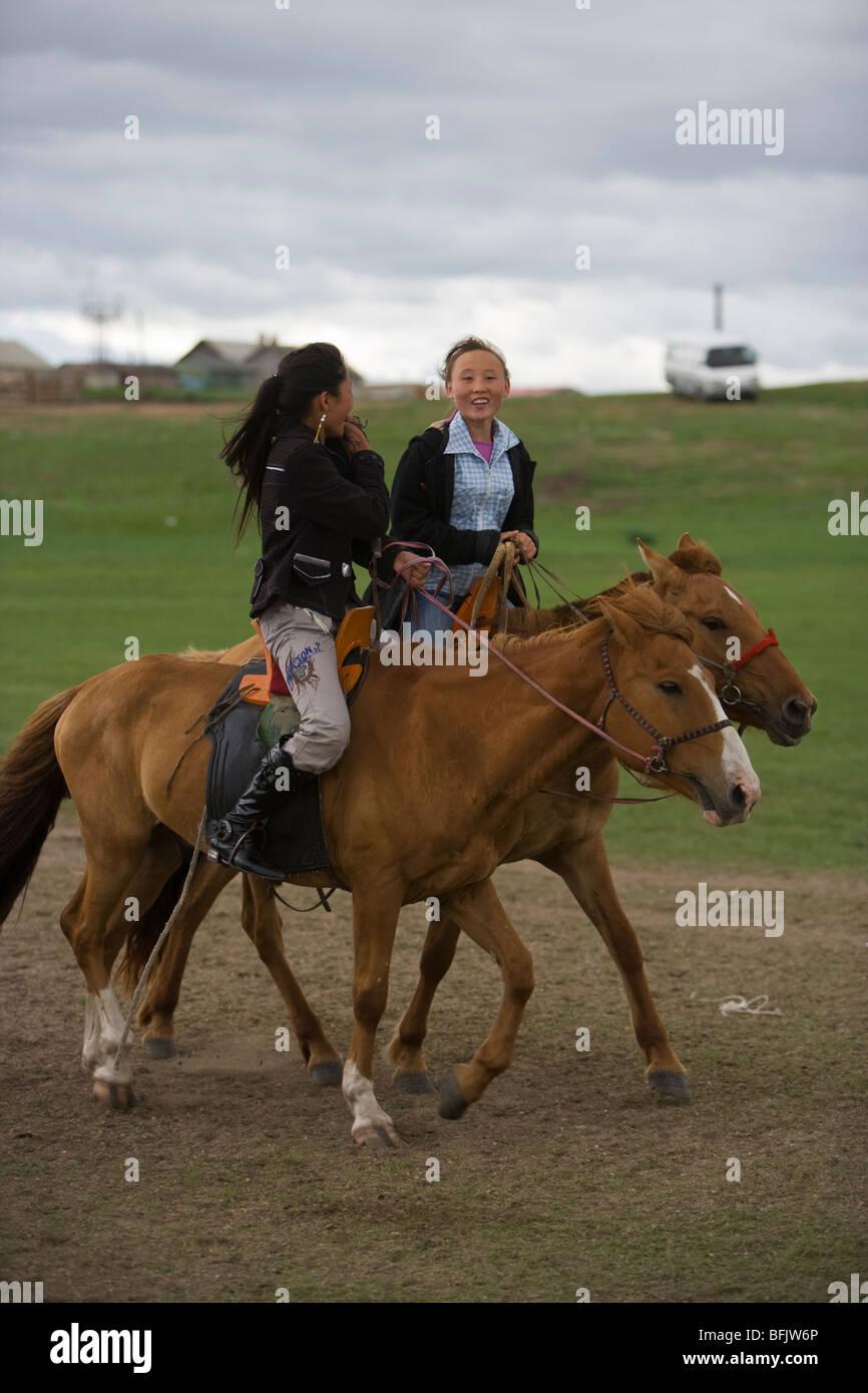 mongolian-girls-riding-horses-during-a-n