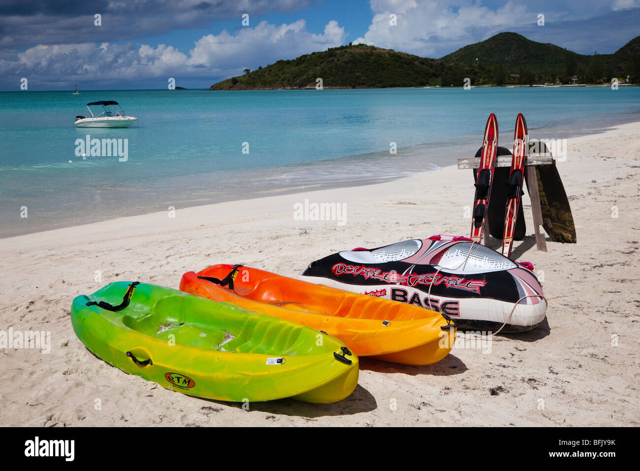 canoes and waterskis on the beach at Lignum Vitae Bay, Antigua - Stock Image