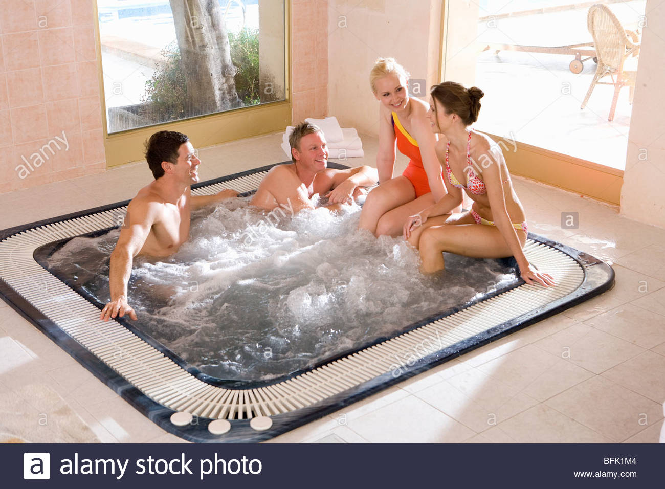 Couples in hot tub Stock Photo: 26848644 - Alamy