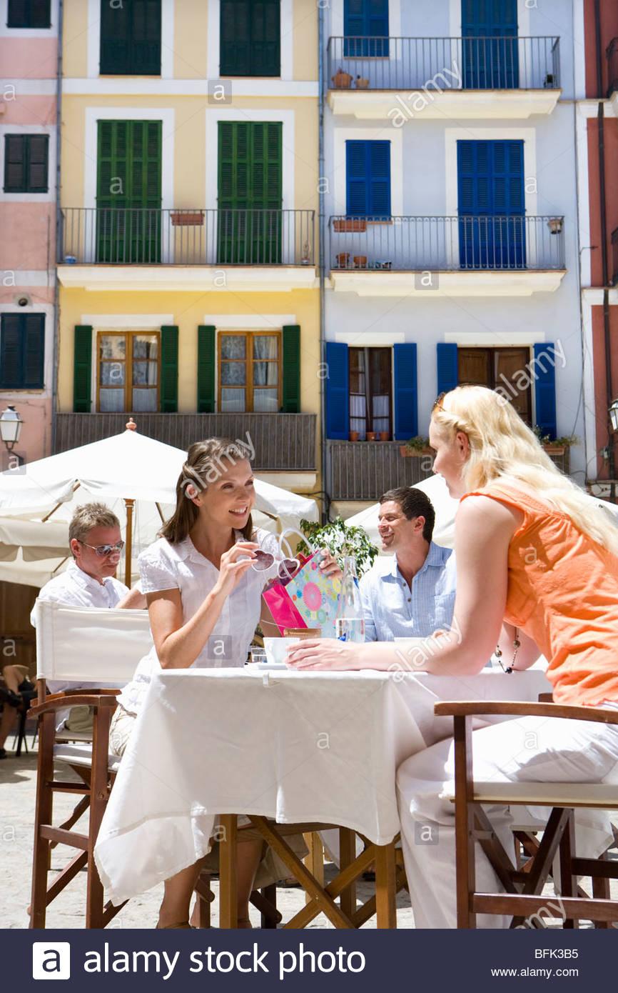 Women at sunny, outdoor café - Stock Image