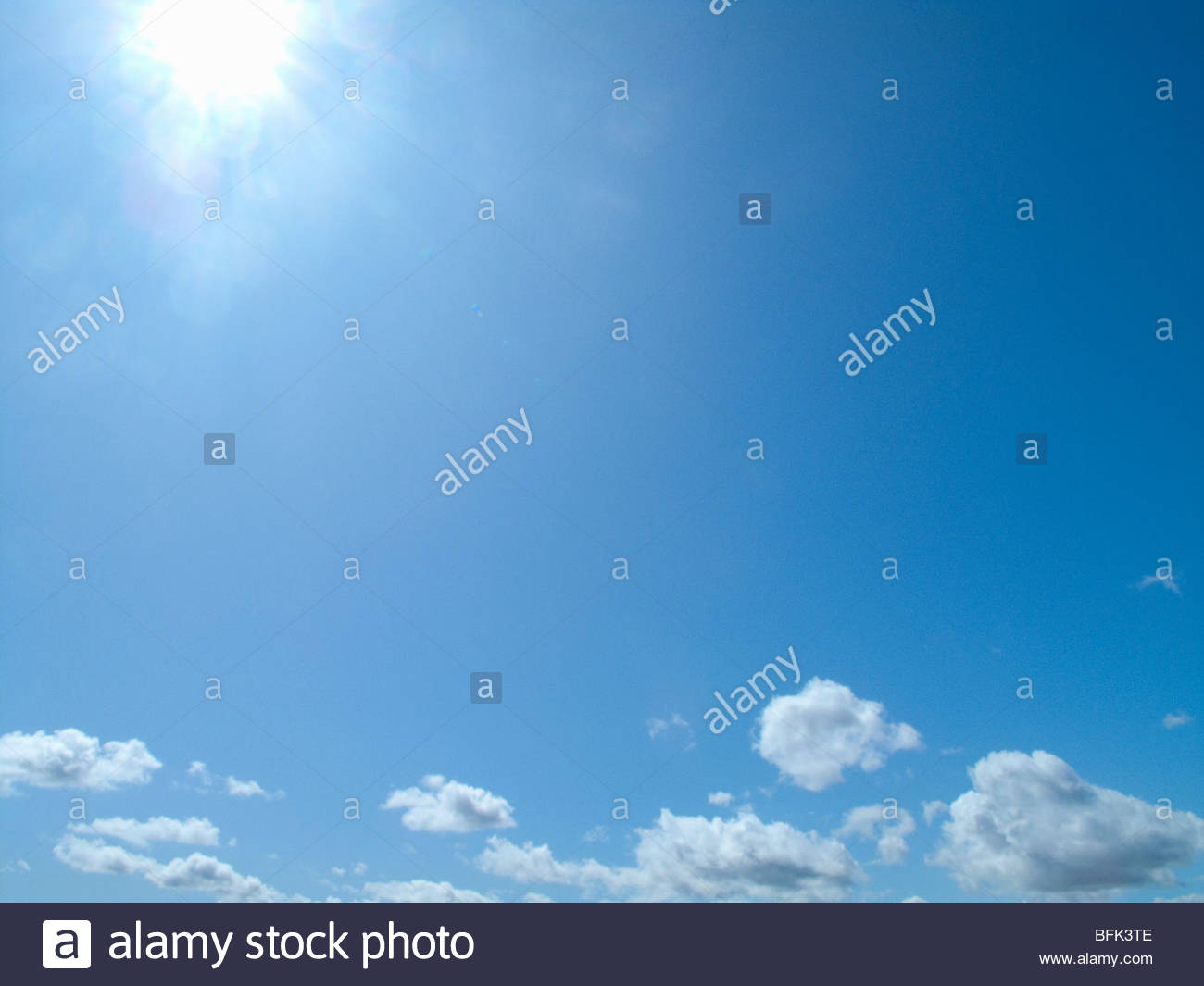 sun shining in blue sky with clouds stock photo 26850334 alamy