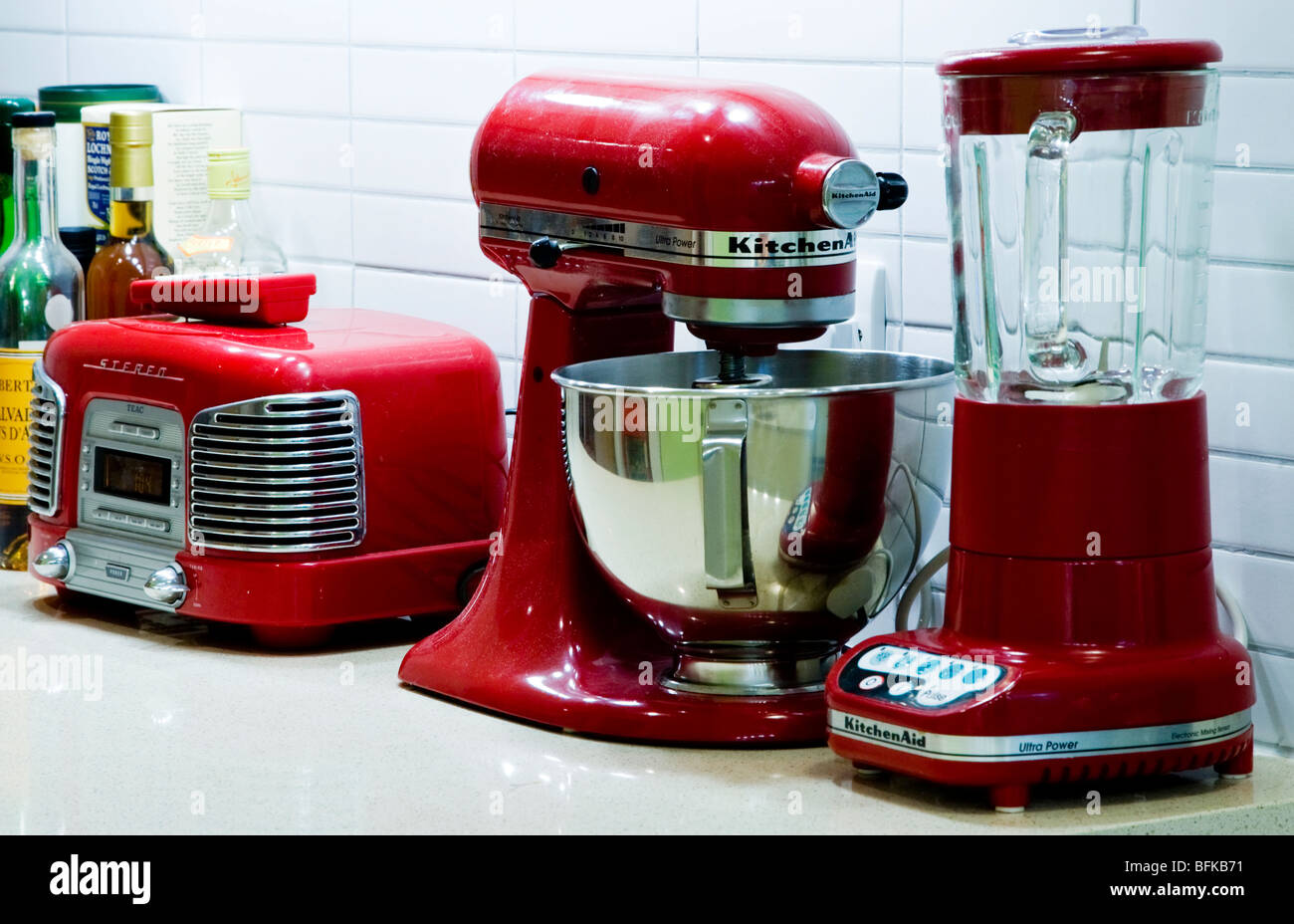 Red retro kitchen appliances on a worktop by KitchenAid Stock Photo ...