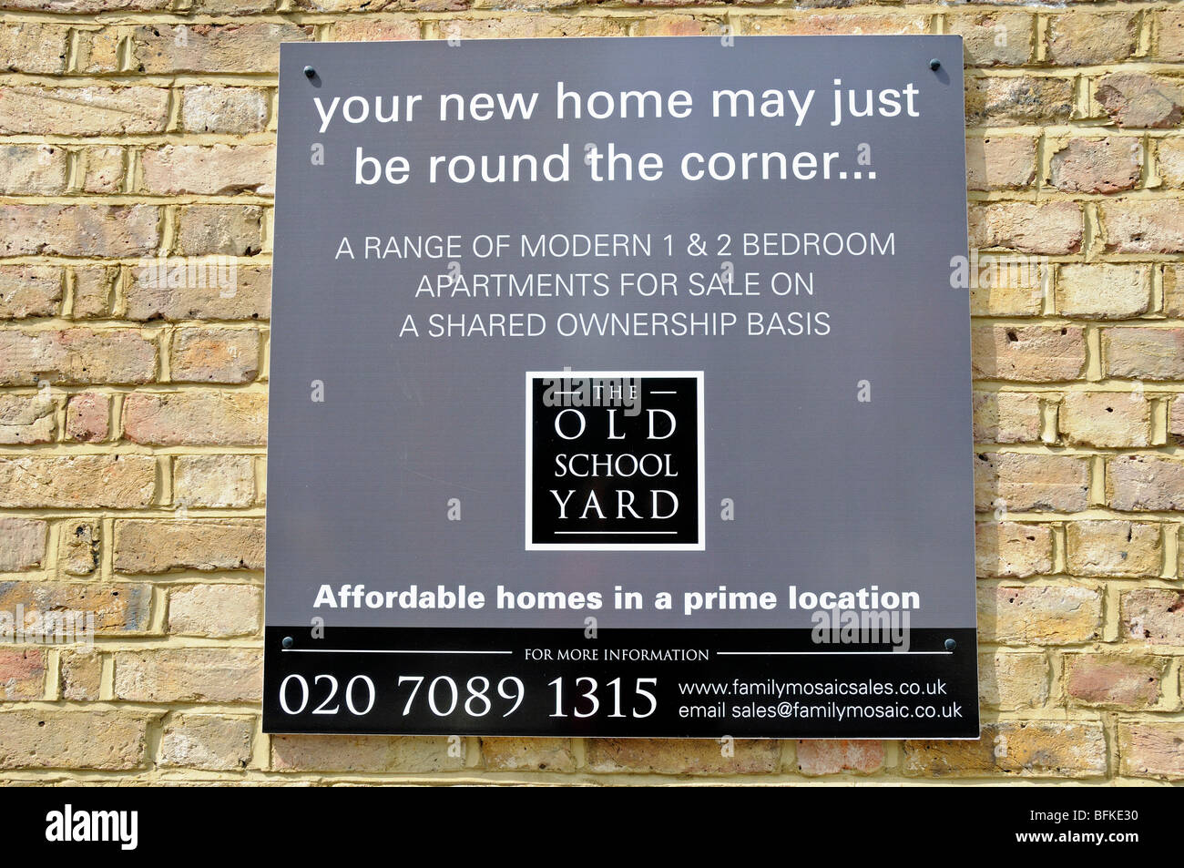 The Old School Yard affordable homes sign Holloway London England UK - Stock Image