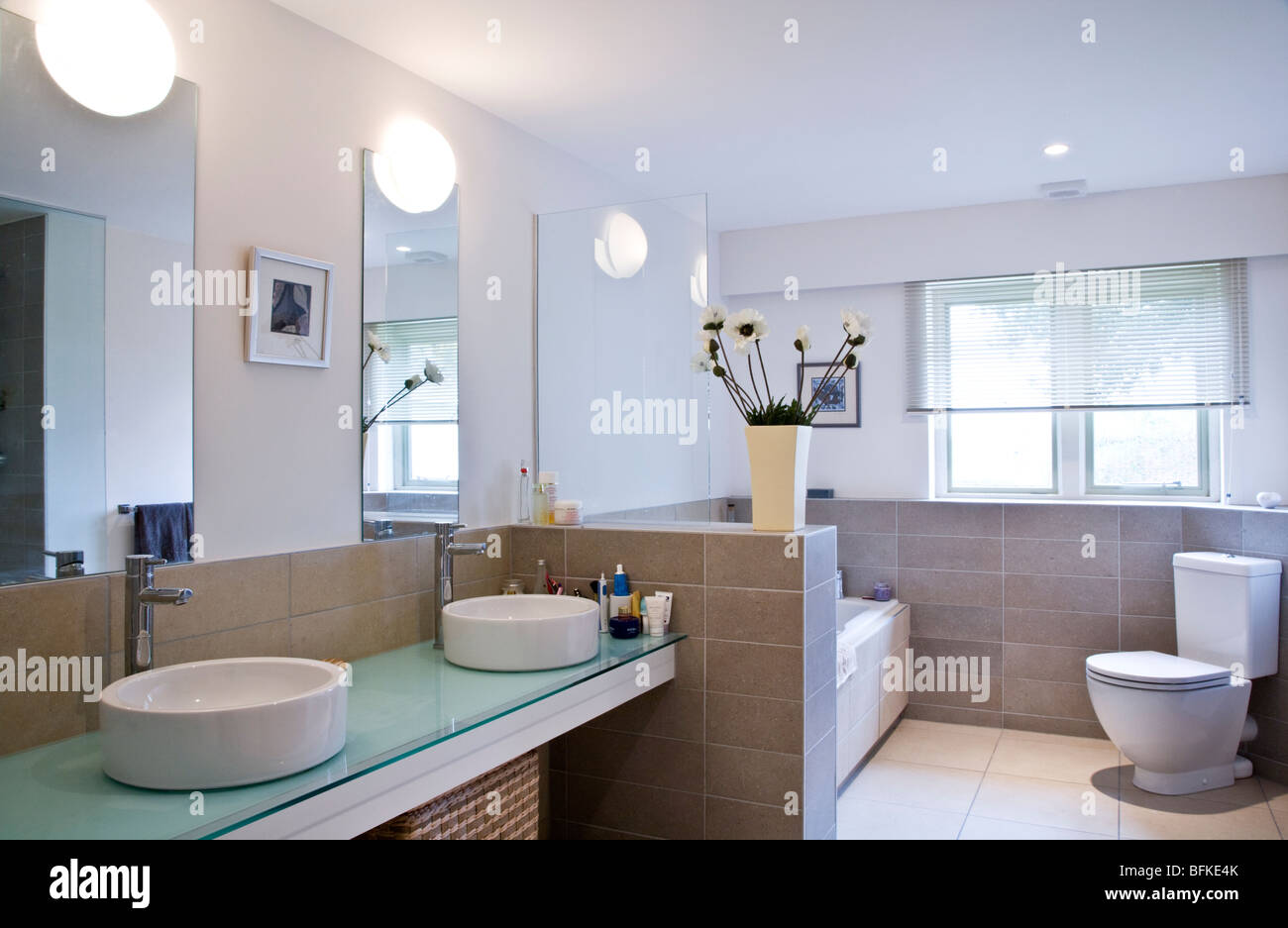 A modern contemporary stylish batthroom with his and hers wash basins - Stock Image