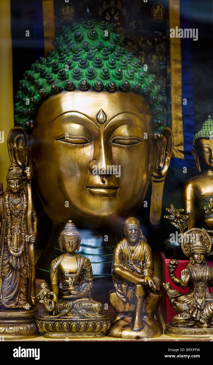 Buddha statues and Indian deity statues in an Indian shop window. Andhra Pradesh, India - Stock Image