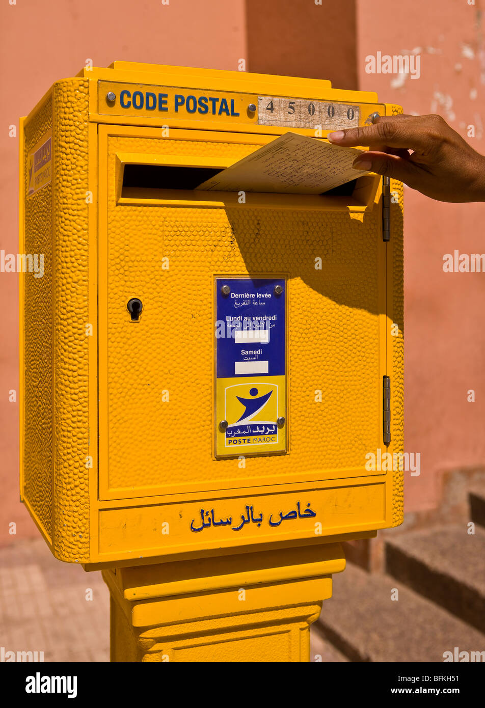 OUARZAZATE, MOROCCO - Mailing postcard in Post office box. - Stock Image