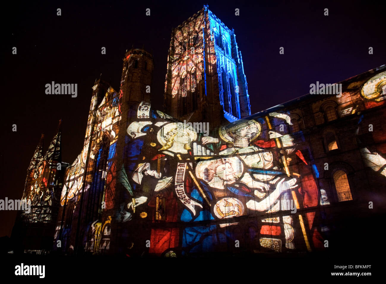 Durham Cathedral is illuminated with art from the Lindisfarne Gospels during 'son et lumiere' at the Lumiere - Stock Image