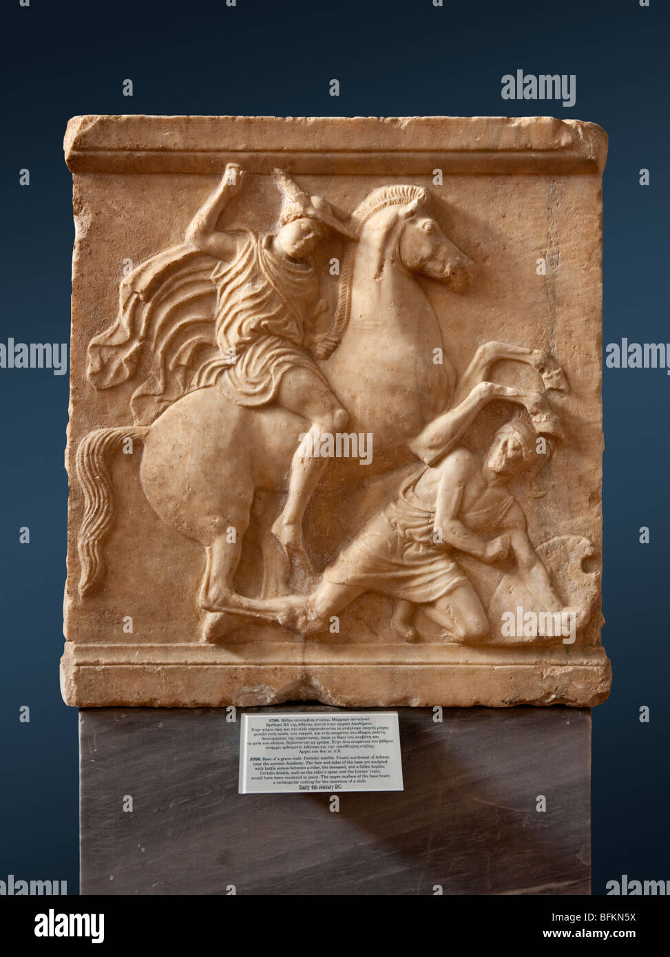 Sculpted base for a funerary stele. Cavalryman battling a fallen hoplite. Ca. 400-390 BC. - Stock Image
