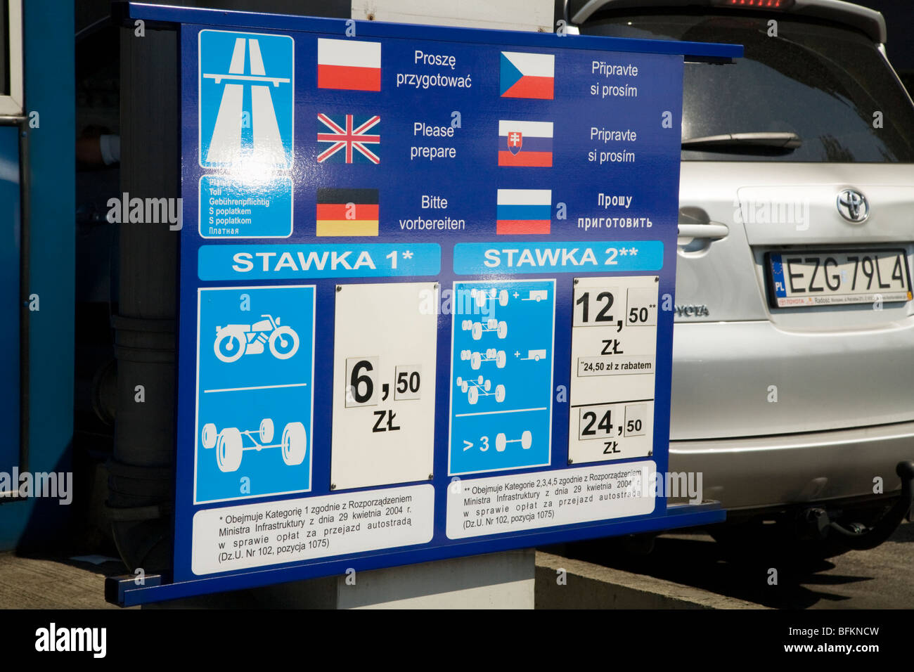 Price list for various vehicles at a Polish motorway toll booth. Near Krakow, Poland. - Stock Image