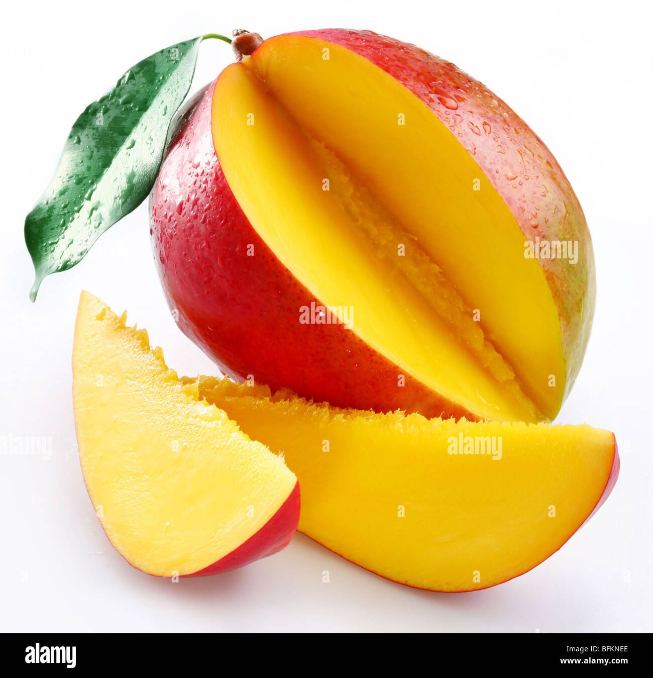 Cut mango with its section on a white background - Stock Image