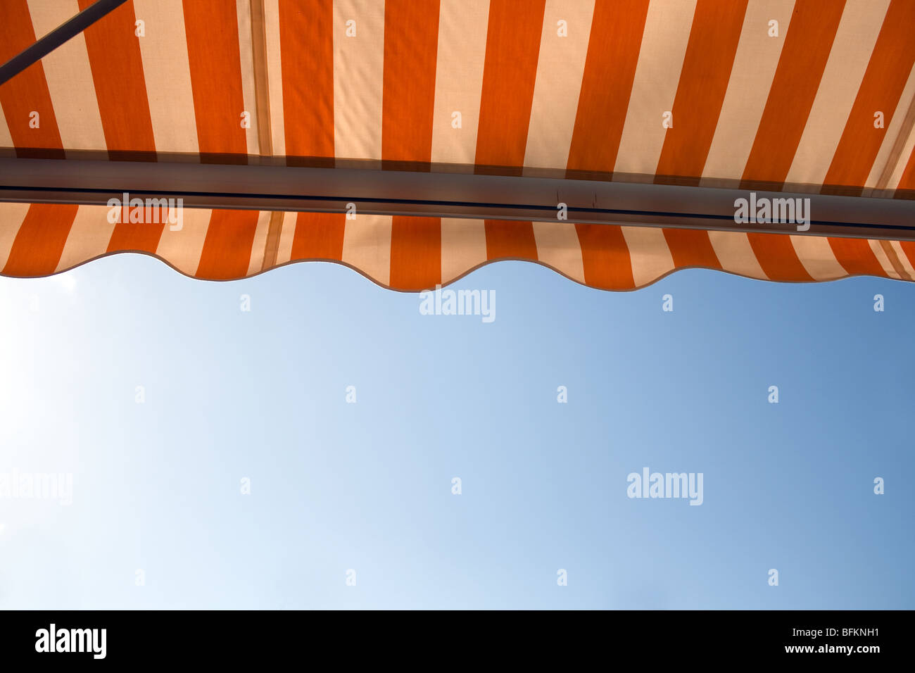 awning over bright sunny blue sky - Stock Image