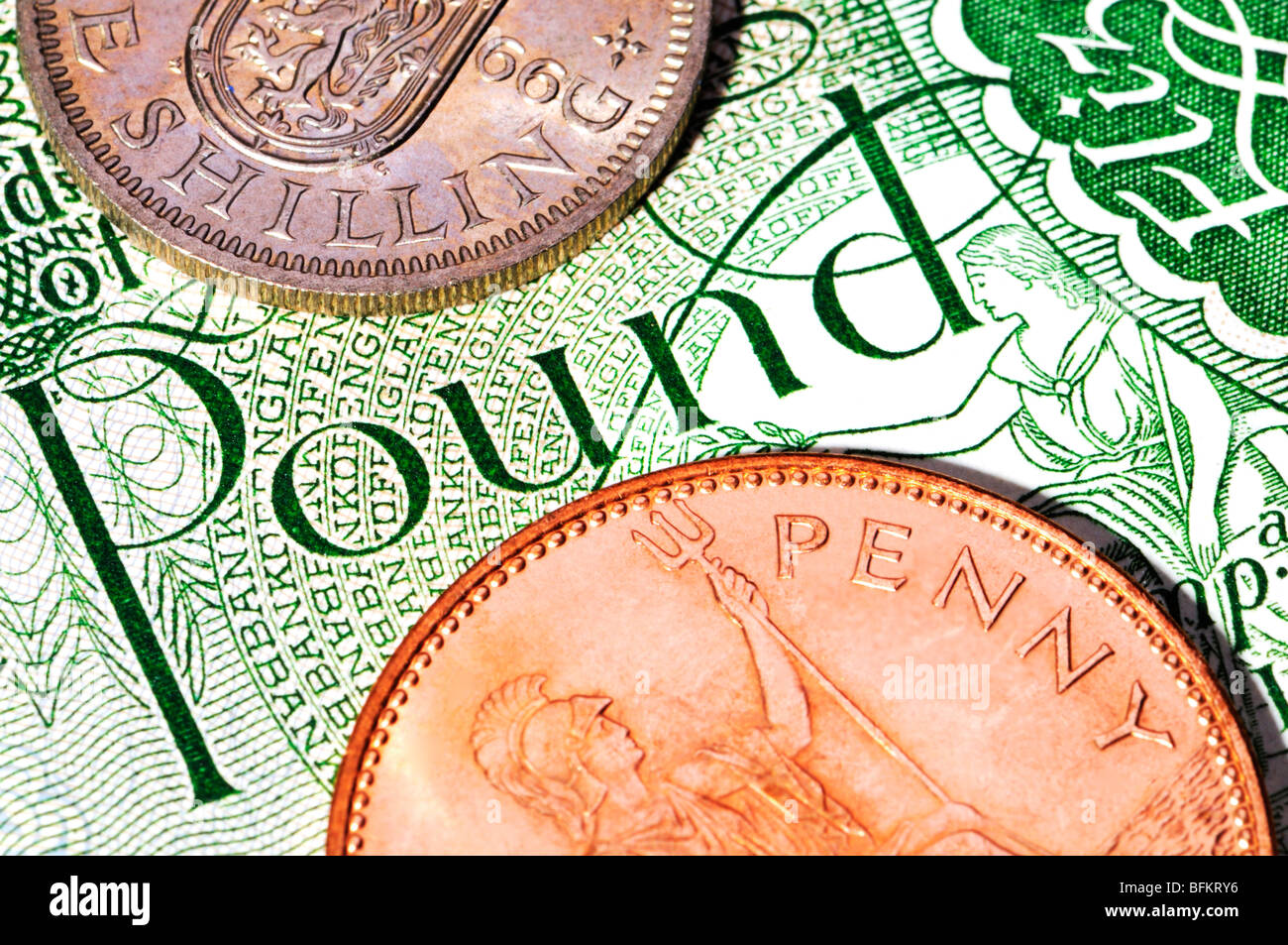 Pre-decimal British coins. Pound, shilling and penny - Stock Image