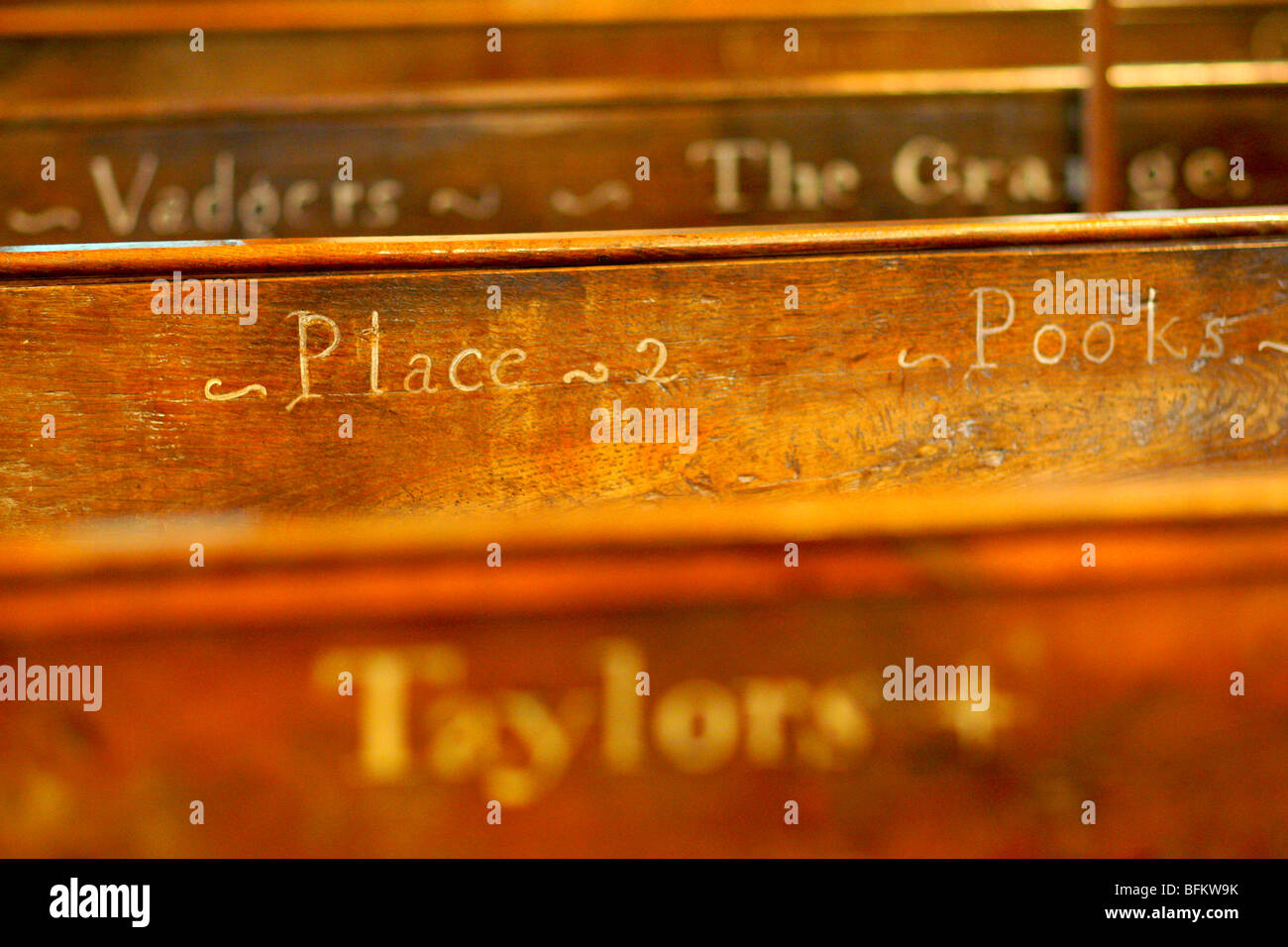 The names of houses in the parish on the C18th pews showing where to sit in Shermanbury parish church Henfield, Stock Photo