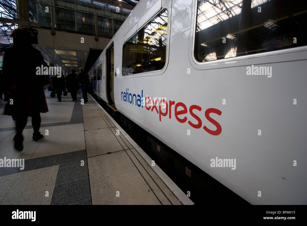 national express train on platform Liverpool street London - Stock Image
