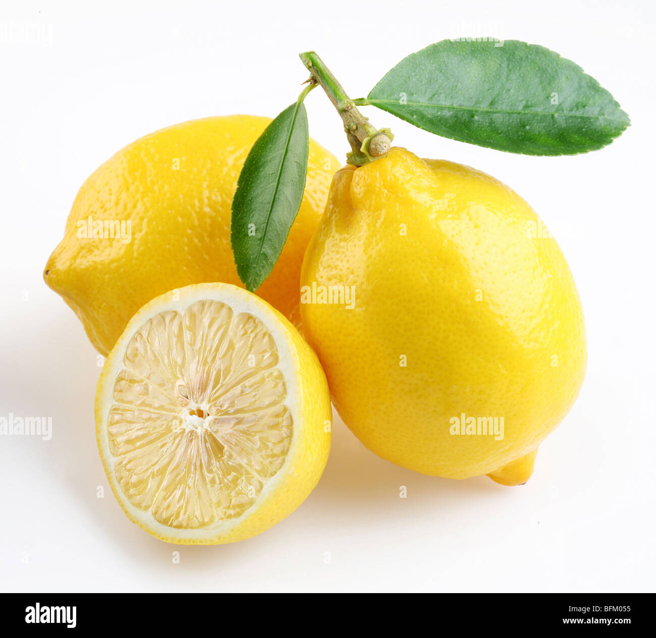 Lemon with section on a white background - Stock Image