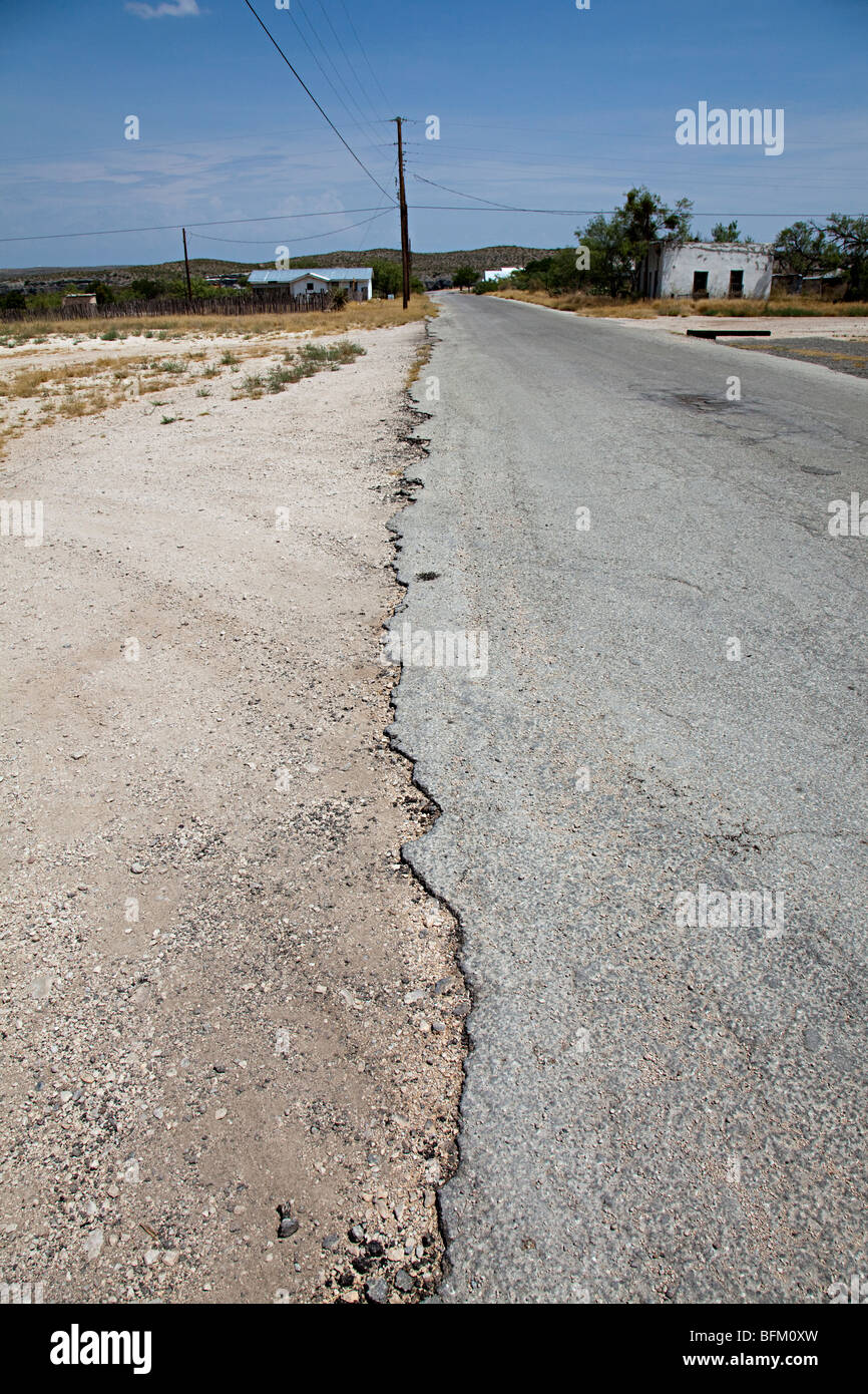 Broken and worn edge of tarmac road Langtry Texas USA - Stock Image