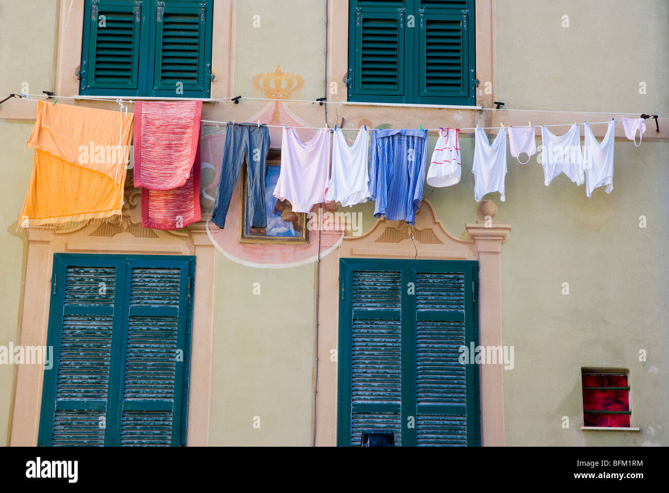 Washing line with drying clothes and house Camogli, Liguria, Italy - Stock Image