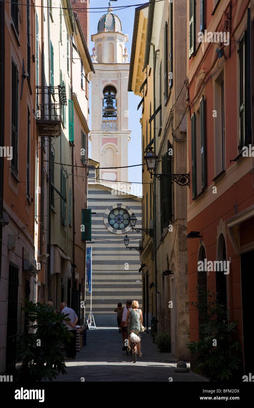 Cathedral and narrow street, Albenga, Liguria, Italy - Stock Image
