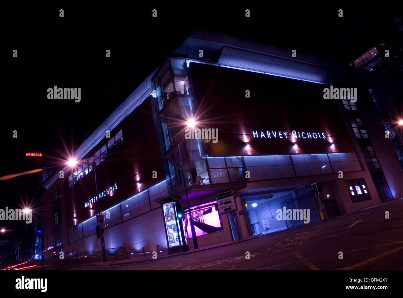 Harvey Nichols and the Arndale Centre at night, central Manchester, UK - Stock Image