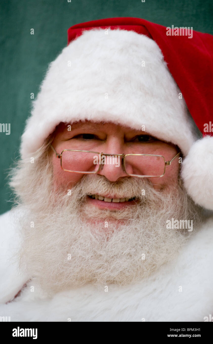 Frontal portrait with slight head tilt of live Santa Claus - Stock Image