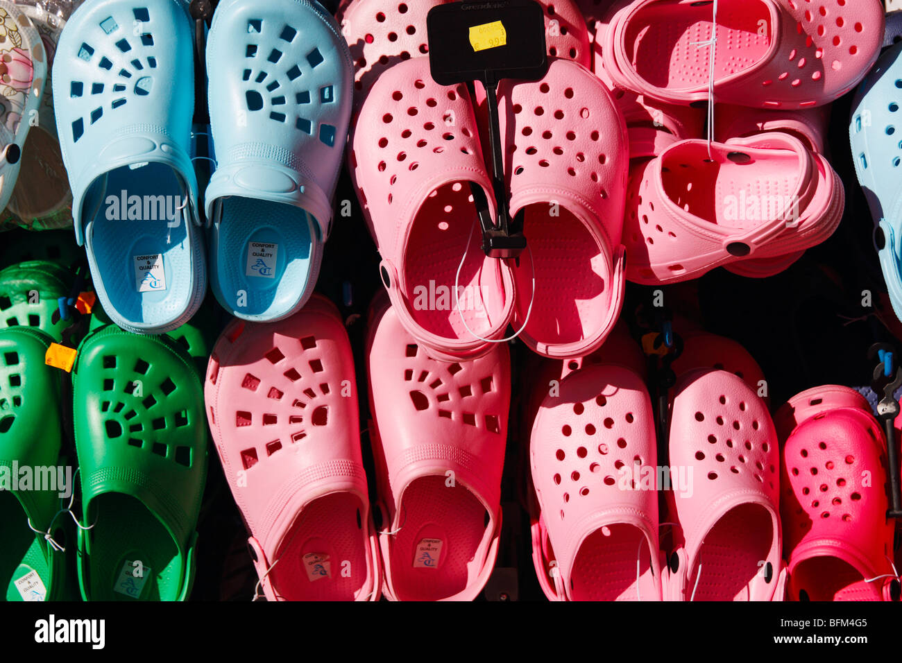Croc sandals on market stall in Spain - Stock Image
