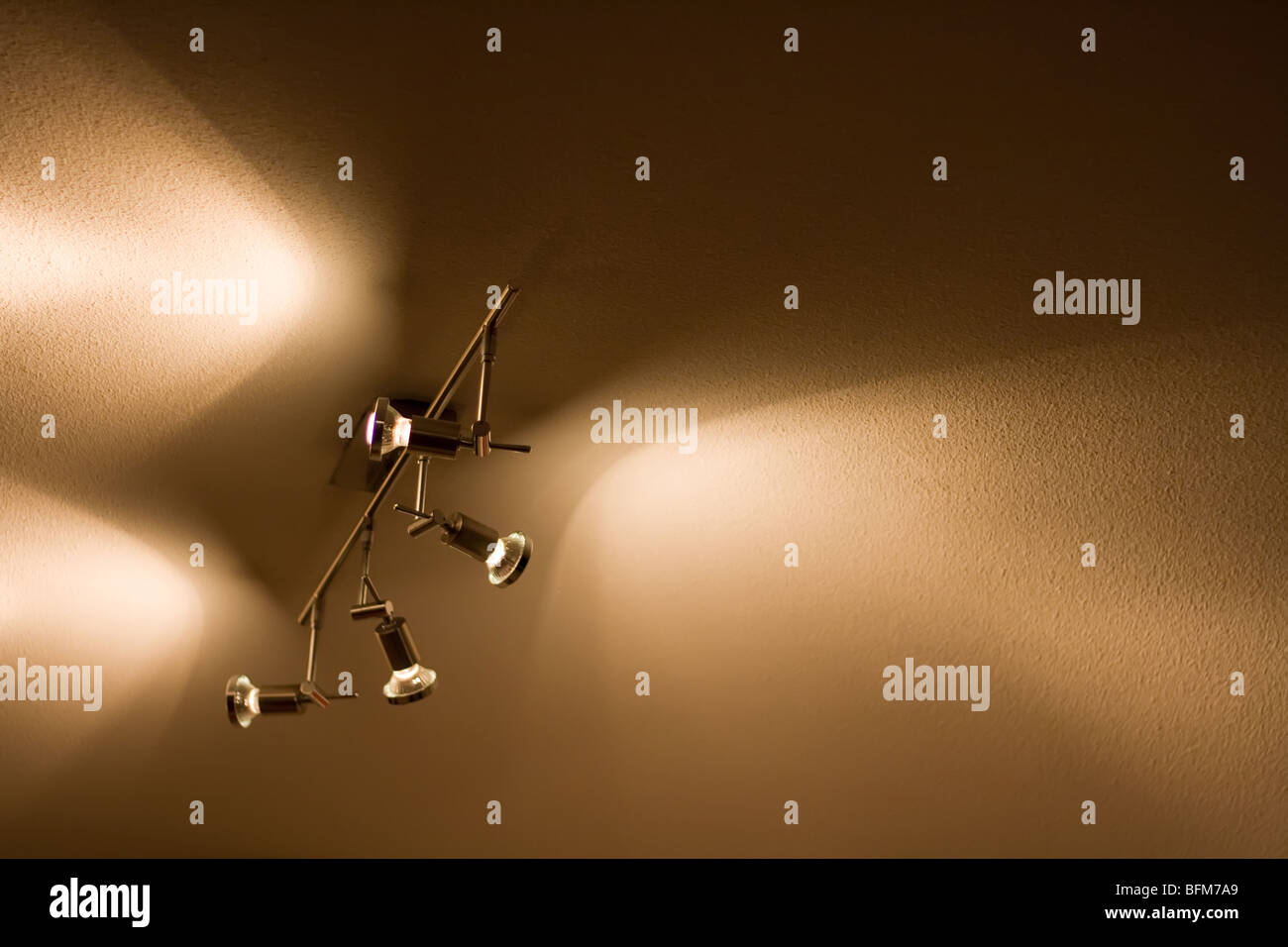 Spot lights shining on the ceiling - Stock Image