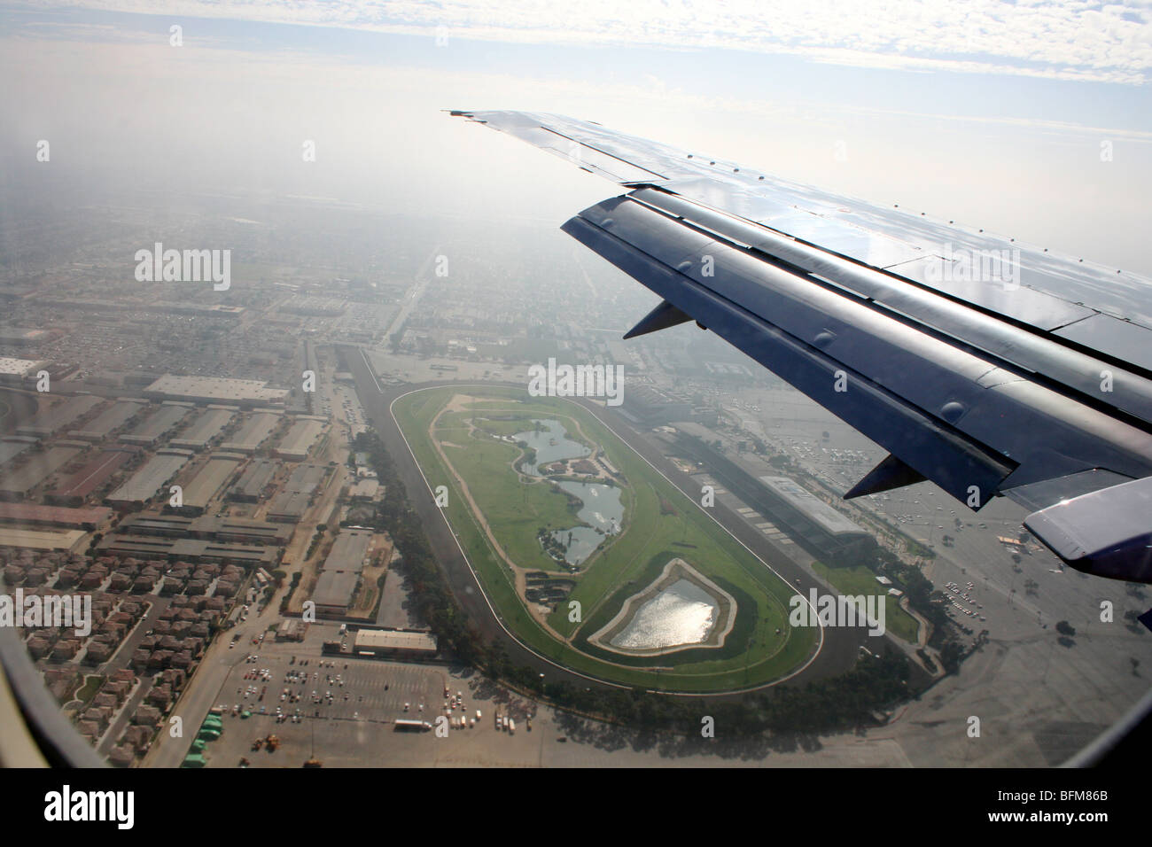 airplane landing in Los Angeles LAX airport areal view land view from above - Stock Image