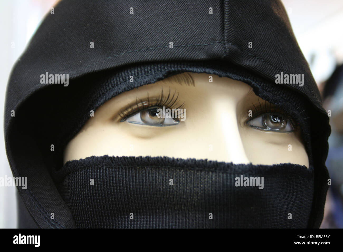 close up of female mannequin dressed in black - Stock Image