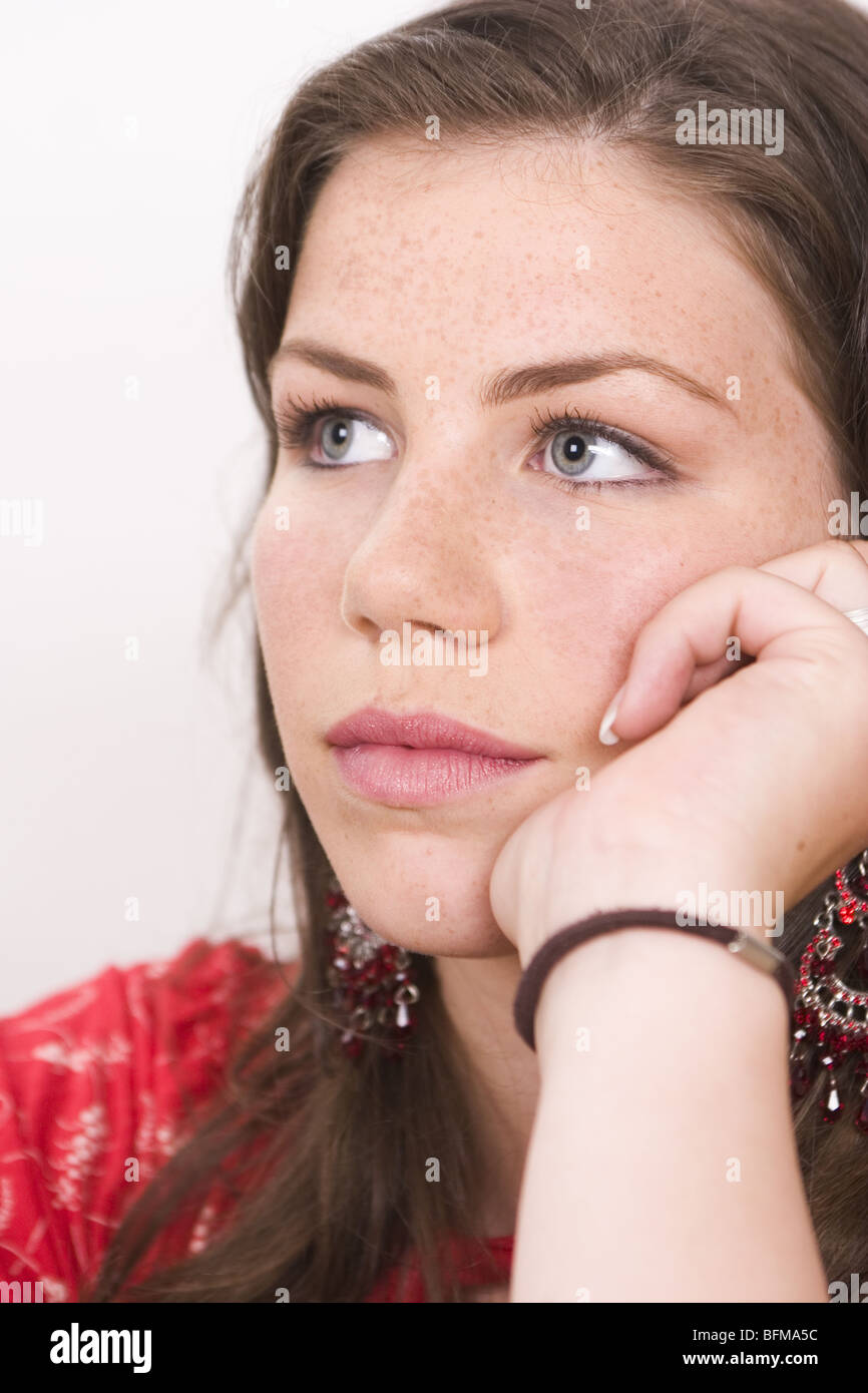 Close up young woman thoughtful looking up - SerieCVS317019 - Stock Image