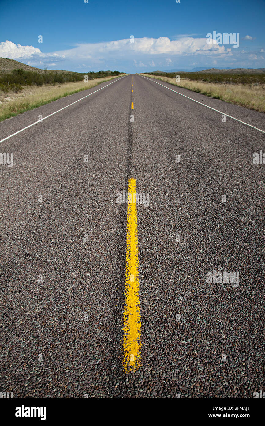 Empty road with yellow line Texas USA - Stock Image