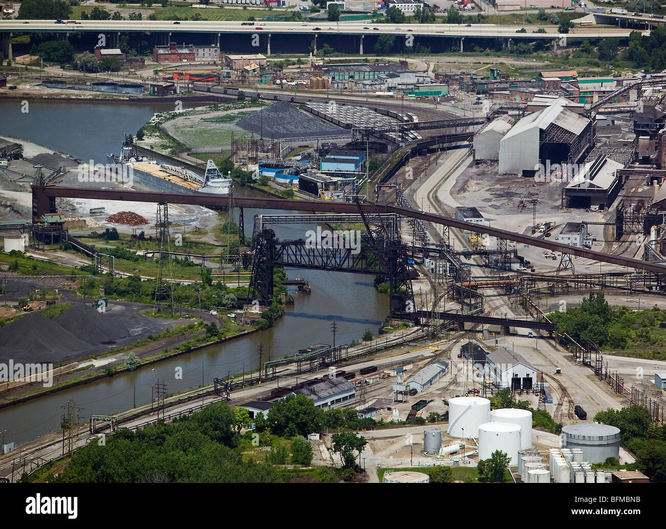 aerial view above Cleveland Ohio industrial area steel mills Cuyahoga river - Stock Image