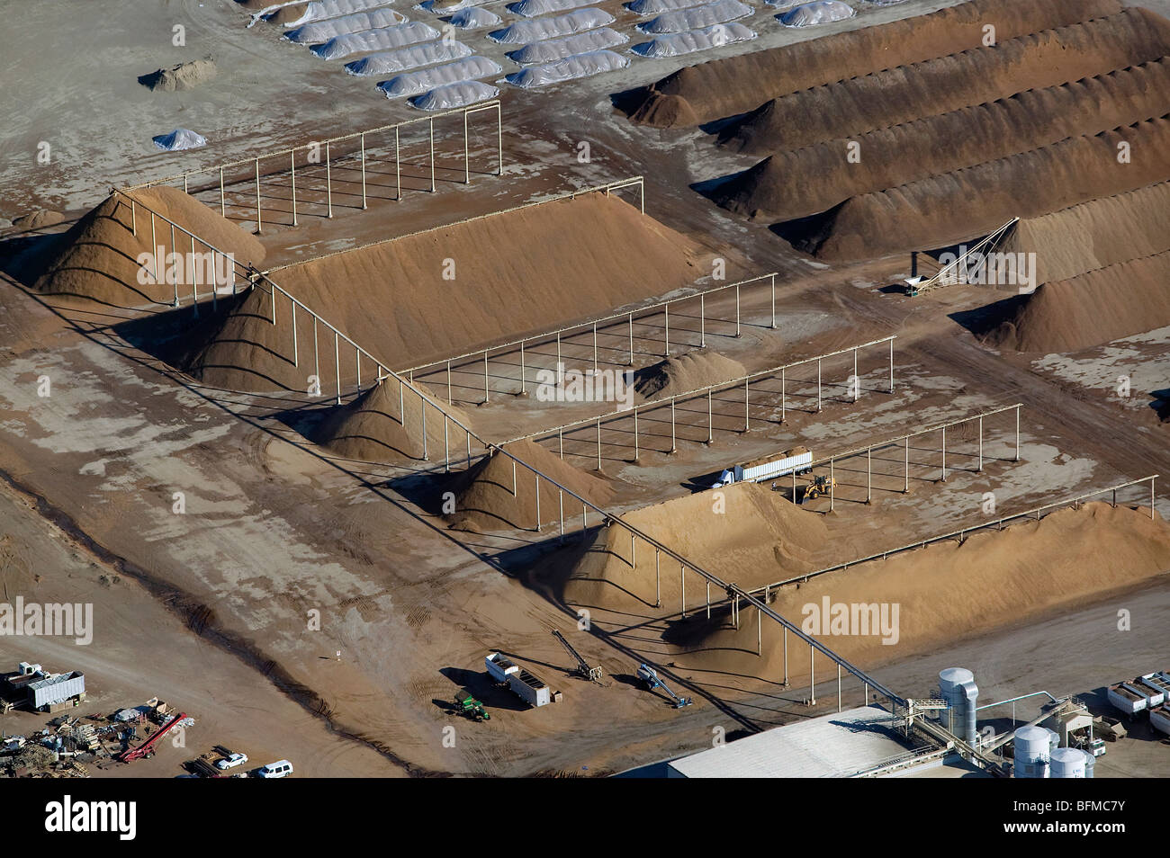aerial view above piles of corn for cattle feed central valley California - Stock Image